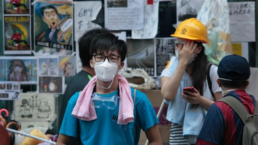 A pro-democracy protester wears his face mask expecting confrontations with police in the Mong Kok district of Hong Kong, Friday, Oct. 17, 2014. Student-led pro-democracy protests have roiled Hong Kong for 20 days - and there remains no clear endgame to the political crisis, the most tumultuous in this semiautonomous Chinese city since it returned to Chinese rule. (AP Photo/Wally Santana)