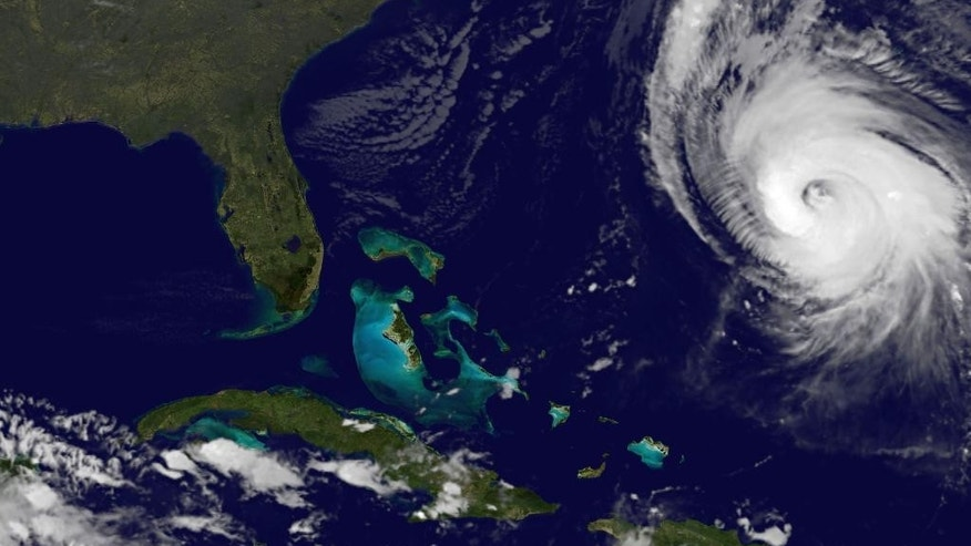 This image provided by NOAA taken at 11:15 p.m. EDT Thursday Oct. 16, 2014 shows Hurricane Gonzalo, right, as it approaches Bermuda. At 11 p.m. Gonzalo was approximately 340 miles south-southwest of Bermuda with maximum sustained winds of 140 mph moving north-northeast at 14 mph according to the National Hurricane Center. Gonzalo was expected to pass within 29 miles (46 kilometers) of Bermuda on Friday night, close enough to be considered a direct hit, the Bermuda Weather Service warned.  (AP Photo/NOAA)