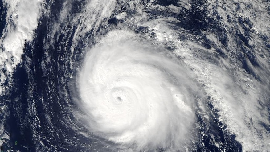This image provided by NASA shows Hurricane Gonzalo taken at 2:45 p.m. EDT by NASA's Aqua satellite. Gonzalo was expected to pass within 29 miles (46 kilometers) of Bermuda on Friday night, close enough to be considered a direct hit, the Bermuda Weather Service warned. Gonzalo is a Category 4 storm late Thursday with top sustained winds of 140 mph (220 kph). It was centered about 340 miles (545 kilometers) south-southwest of Bermuda and was moving north-northeast at 14 mph (22 kph), the U.S. National Hurricane Center said. (AP Photo/NASA)
