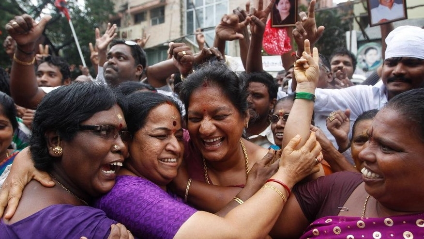 Supporters of former chief minister of Tamil Nadu state Jayaram Jayalalitha, a former movie star, celebrate the news of bail being granted to their leader, outside their party office in Chennai, India, Friday, Oct. 17, 2014. India's top court Friday granted temporary bail to the charismatic southern Indian politician who was sentenced to four years in prison after being found guilty of corruption last month. The 65-year-old requested bail because she said she suffered from diabetes and high blood pressure and needed medical attention. (AP Photo/Arun Sankar K)