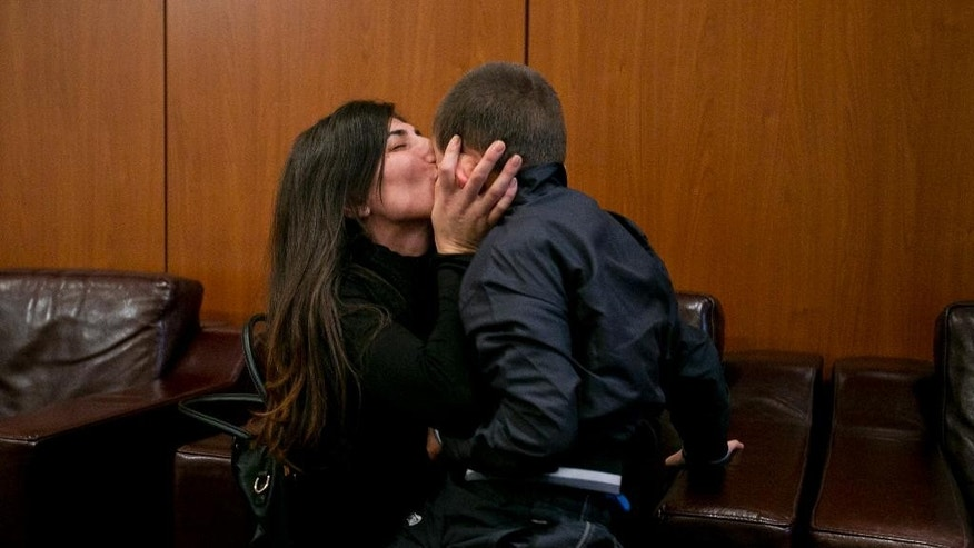 Pranvera Abazi kisses her son Erion Zena during their reunion at Kosovo's main airport upon his return to Kosovo's capital Pristina on Wednesday, Oct. 15, 2014. Kosovo's Prime Minister says the country's intelligence and security forces have returned an 8-year-old ethnic Albanian boy to his mother in Kosovo after he was taken by his jihadi father to Syria. (AP Photo/Visar Kryeziu)