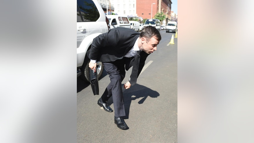 Oscar Pistorius adjust trouser as he arrives at the high court in Pretoria, South Africa, Friday, Oct. 17, 2014. Following the testimony hearing, which is expected to end this week, Judge Thokozile Masipa will rule on what punishment Pistorius must serve after convicting him of culpable homicide for shooting his girlfriend Reeva Steenkamp through a toilet door in his home. (AP Photo)