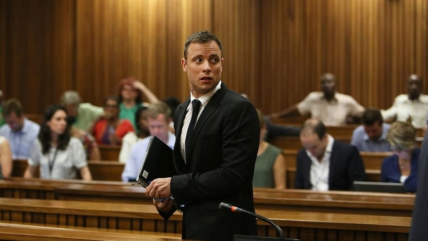 Oscar Pistorius, at the end of the fourth day of  sentencing proceedings in the high court in Pretoria,  South Africa, Thursday, Oct. 16, 2014. Following the testimony hearing, which is expected to end this week, Judge Thokozile Masipa will rule on what punishment Pistorius must serve after convicting him of culpable homicide for shooting his girlfriend Reeva Steenkamp through a toilet door in his home. (AP Photo/Alon Skuy, Pool)