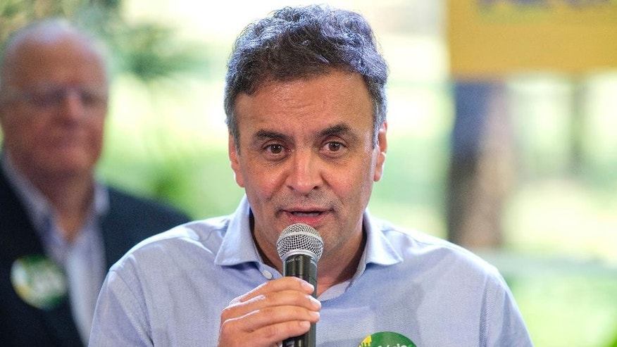 Aecio Neves, who is running for president with the Brazilian Social Democracy Party, speaks at a campaign event in Sao Paul, Brazil, Friday, Oct. 17, 2014. Neves will face Brazil's President Dilma Rousseff in a presidential runoff on Oct. 26. (AP Photo/Andre Penner)
