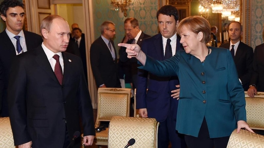 German Chancellor Angela Merkel, right, Russian President Vladimir Putin, left, and  Italian Prime Minister Matteo Renzi arrive for a meeting on the sidelines of the  ASEM summit of European and Asian leaders in Milan, northern Italy, Friday, Oct. 17, 2014. Russian President Vladimir Putin is looking to get relief from Western economic sanctions imposed since Russia's annexation of the Crimean Peninsula and its support for a pro-Russia insurgency in eastern Ukraine. To that end, he has scheduled a series of meetings on the sidelines of a two-day ASEM summit of European and Asian leaders. (AP Photo/Daniel Dal Zennaro, POOL)