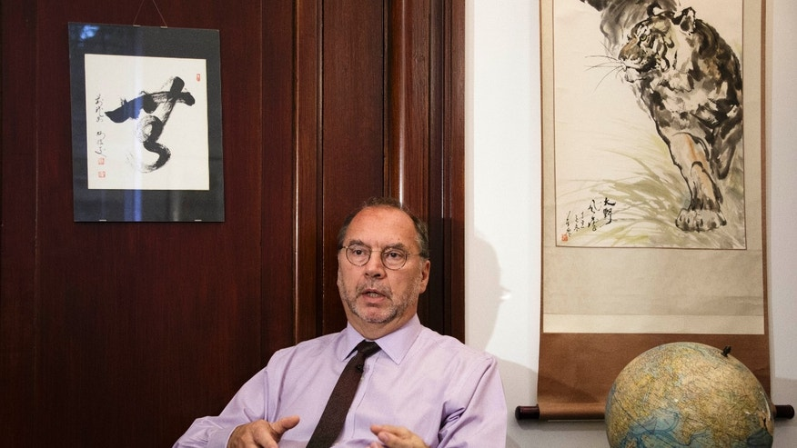 Oct. 17, 2014 - Dr. Peter Piot, the co-discoverer of the Ebola virus, speaks with The AP at his office at the London School of Hygiene and Tropical Medicine. Piot questioned why it took the World Health Organization 5 months and 1,000 deaths before the agency declared Ebola an international health emergency in August.