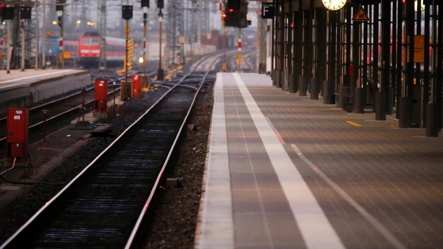 Empty platforms are seen as German train drivers went on strike to demand pay hike and better work conditions in Frankfurt, Germany, Saturday, Oct. 18, 2014. A union representing German train drivers has called members out on a two-day strike this Saturday and Sunday, escalating a bitter pay dispute with national railway Deutsche Bahn. (AP Photo/Michael Probst)