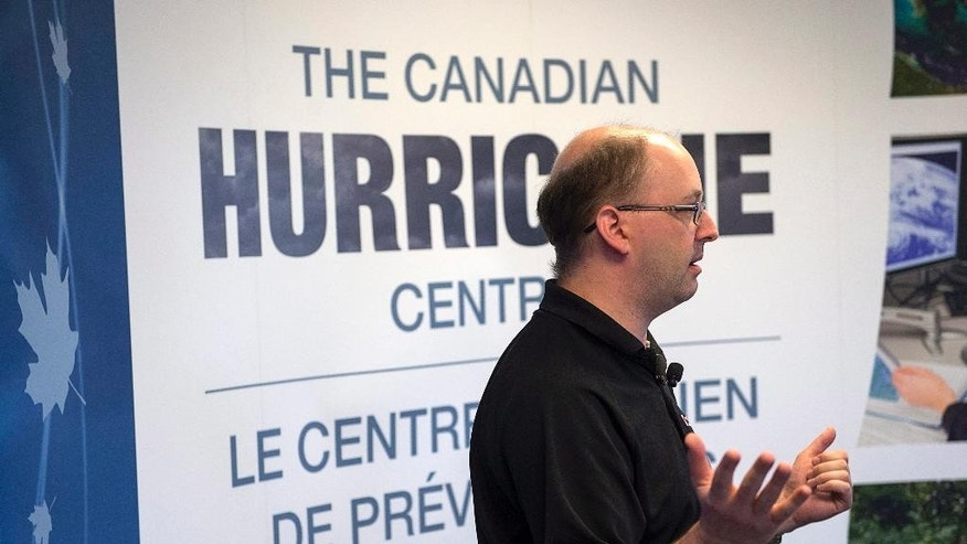 Chris Fogarty, a senior meteorologist at the Canadian Hurricane Centre, provides an update on Hurricane Gonzalo in Dartmouth, Nova Scotia, Friday, Oct. 17, 2014. Forecasters said there is a possibility of Gonzalo making landfall in the southeastern tip of Newfoundland and Labrador on Sunday. Hurricane Gonzalo roared toward Bermuda as a powerful Category 3 storm on Friday and the head of the tiny British territory urged people to seek high ground due to a potential storm surge of 10 feet. (AP Photo/The Canadian Press, Andrew Vaughan)