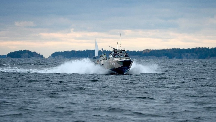 "A Swedish Navy fast-attack craft cuts through the water in the the Stockholm Archipelago, Sweden,  Saturday Oct. 18 2014. Sweden's military continues to investigate reports of ""foreign underwater activity"" in the Stockholm archipelago using high-tech equipped naval vessels, aircraft and home guard forces.  (AP Photo/TT News Agency/Pontus Lundahl)   SWEDEN OUT"