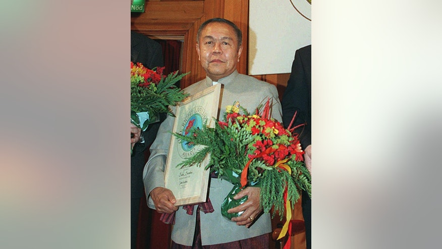 "FILE - In this Dec. 8, 1995 file photo, Sulak Sivaraksa from Thailand poses for a photo during an award ceremony of the 1995 Right Livelihood Award, also called the ""alternative Nobel Prize,"" in Stockholm, Sweden. Sulak, one of Thailand's most prominent intellectuals, is the target of a criminal complaint for comments he made about a Thai king who died more than 400 years ago, Police Col. Thiravit Busaban said Saturday, Oct. 18, 2014. Eighty-two-year-old Sulak was cited by two retired senior army officers on charges of lese majeste, or insulting the monarchy. If convicted, he could be imprisoned for up to 15 years. In Thailand, anyone can file a lese majeste complaint with police, and the charge has frequently been used as a weapon to harass political enemies. (AP Photo/Eric Roxfelt, File)"