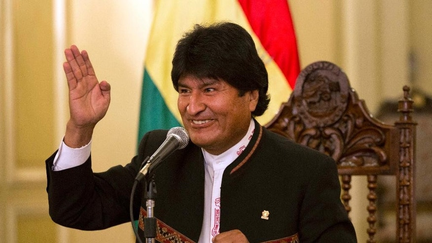 Bolivia's President Evo Morales speaks during a news conference at Government Palace in La Paz, Bolivia, Monday, Oct. 13, 2014. Morales coasted to victory in Bolivia's Sunday presidential elections, winning an unprecedented third term as voters rewarded the former coca grower for delivering economic and political stability in what has traditionally been one of South America's most ungovernable nations. (AP Photo/Martin Mejia)