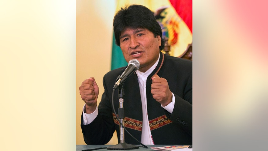 Bolivia's President Evo Morales speaks during a news conference at Government Palace in La Paz, Bolivia, Monday, Oct. 13, 2014. Morales coasted to victory in Sunday presidential elections, winning an unprecedented third term as voters rewarded the former coca grower for delivering economic and political stability in what has traditionally been one of South America's most ungovernable nations. (AP Photo/Martin Mejia)