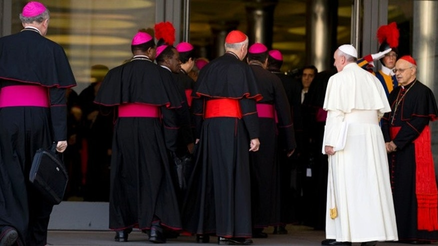 Oct. 18, 2014: Pope Francis, right, arrives with bishops and cardinals to attend an afternoon session of a two-week synod on family issues at the Vatican.