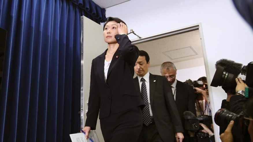 Japanese Trade and Industry Minister Yuko Obuchi arrives at a press conference at her ministry in Tokyo Monday, Oct. 20, 2014. Obuchi resigned Monday amid growing controversy over allegations that she misused campaign funds. (AP Photo/Koji Sasahara)