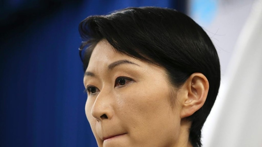 Japanese Trade and Industry Minister Yuko Obuchi announces her resignation during a press conference at her ministry in Tokyo Monday, Oct. 20, 2014. Obuchi resigned Monday amid growing controversy over allegations that she misused campaign funds. (AP Photo/Koji Sasahara)