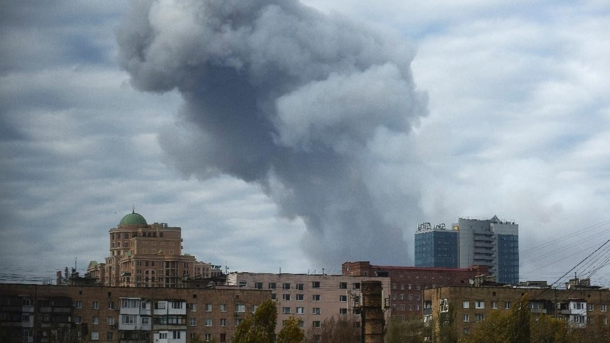 Oct. 20, 2014 - Smoke rises after shelling in the city of Donetsk, eastern Ukraine. A powerful explosion shook the largest rebel-controlled city in eastern Ukraine as daily battles continue in the region despite a nominal cease-fire.