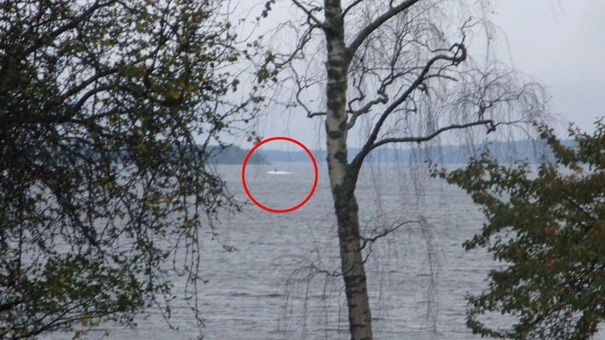 Sweden released a grainy photo depicting a craft surrounded by white ripples. (Photo courtesy inquisitr.com)
