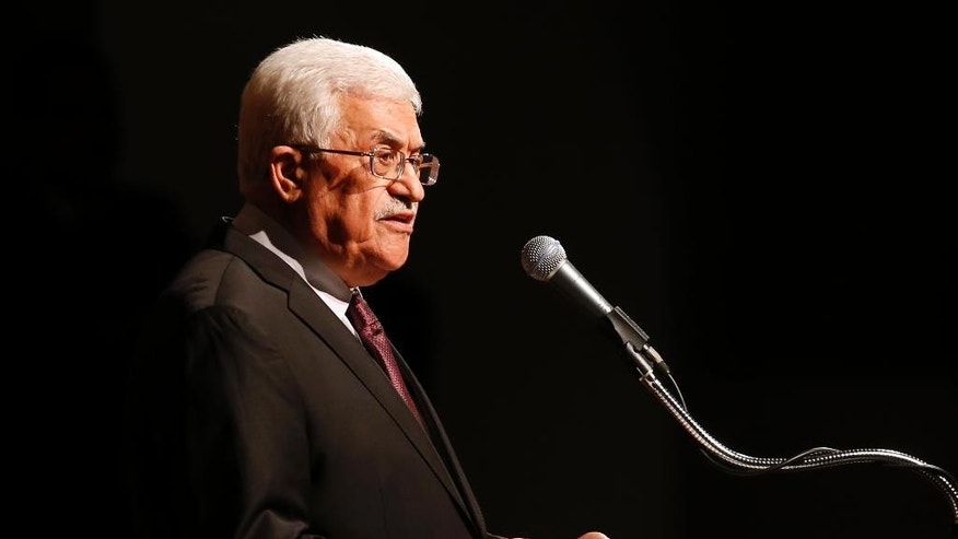 "FILE -- In this Sept. 22, 2014 file photo, Palestinian President Mahmoud Abbas delivers a speech at Cooper Union in New York. The Palestinian president has been speaking in increasingly belligerent tones in recent weeks, accusing Israel of committing ""genocide"" in Gaza and calling on Palestinians to defend a contested Jerusalem holy site ""by any means."" The heightened rhetoric is a departure for the normally staid Abbas - and an apparent sign of desperation as he tries to halt a slide in popularity following this summer's war between Israel and the Islamic militant Hamas in Gaza. (AP Photo/Jason DeCrowd, File)"