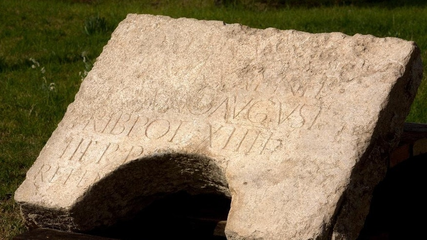 A commemorative inscription dedicated to the Emperor Hadrian that was found outside Jerusalem's Old City, is on display at the Rockefeller museum in Jerusalem, Tuesday, Oct. 21, 2014. Israeli archaeologists said Tuesday they have discovered a large stone with Latin engravings that lends credence to the theory that the reason Jews revolted against Roman rule nearly 2,000 ago was because of their harsh treatment. Israel's Antiquities Authority said the stone bears the name of the Roman emperor Hadrian and the year of his visit to Jerusalem, a few years before the failed Bar Kochba revolt in the second century A.D.  (AP Photo/Sebastian Scheiner)