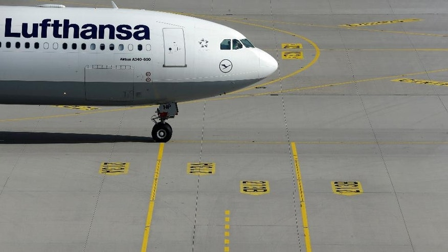 A Lufthansa airplane arrives at the airport in Munich, southern Germany, Monday Oct. 20, 2014.  A planned strike by pilots at Lufthansa has been expanded to include a one-day walkout Tuesday at the German airline's long-haul fleet. The Vereinigung Cockpit union already had announced a 35-hour strike at Lufthansa's short-haul fleet starting mid-Monday, the latest in a string of walkouts over retirement benefits. It expanded that to target long-haul services from 6 a.m. (0400 GMT) to midnight (2200 GMT) Tuesday. (AP Photo/Matthias Schrader)