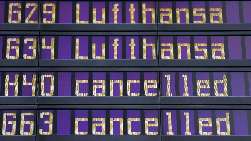 Cancelled Lufthansa flights are displayed at the airport in Munich, southern Germany, Monday Oct. 20, 2014. A planned strike by pilots at Lufthansa has been expanded to include a one-day walkout Tuesday at the German airline's long-haul fleet. The Vereinigung Cockpit union already had announced a 35-hour strike at Lufthansa's short-haul fleet starting mid-Monday, the latest in a string of walkouts over retirement benefits. It expanded that to target long-haul services from 6 a.m. (0400 GMT) to midnight (2200 GMT) Tuesday. (AP Photo/Matthias Schrader)