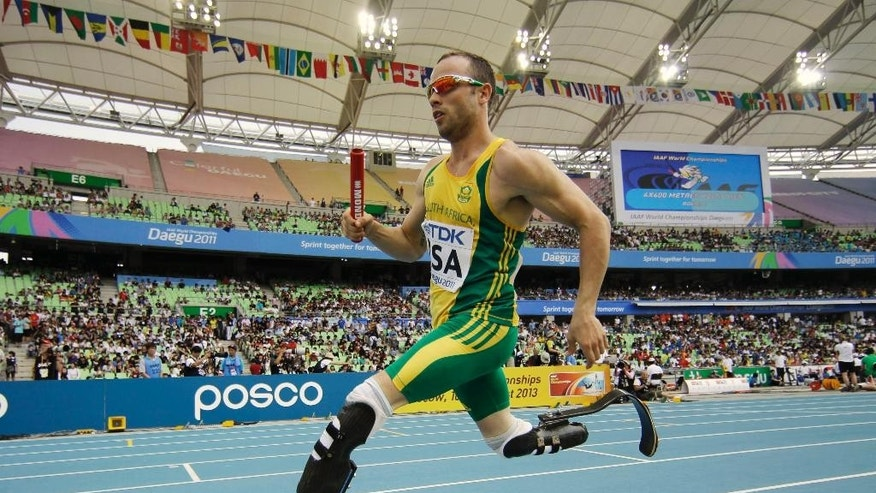 FILE - In this Sept. 1, 2011 file photo, South Africa's Oscar Pistorius competes in a qualification round for the Men's 4x400m relay at the World Athletics Championships in Daegu, South Korea.  Double-amputee Olympic runner Oscar Pistorius has been sentenced to five years in prison for the killing of his girlfriend Reeva Steenkamp. Pistorius, who shot and killed Steenkamp through a toilet cubicle door in his home last year, had earlier been convicted of culpable homicide, or negligent killing. (AP Photo/Matt Dunham, File)