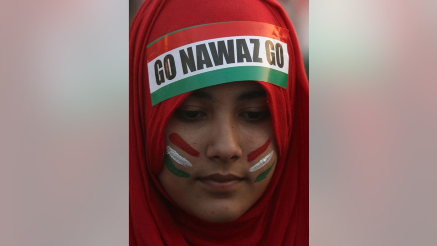 A woman supporter of Pakistan's fiery cleric Tahir-ul-Qadri takes part in an anti government rally in Lahore, Pakistan, Sunday, Oct. 19, 2014. Thousands of anti-government protestors  led Muslim cleric Tahir-ul-Qadri rallied in Lahore demanding Prime Minister Nawaz Sharif's ouster over alleged fraud in last year's election. (AP Photo/K.M. Chaudary) (AP Photo/K.M. Chaudary)
