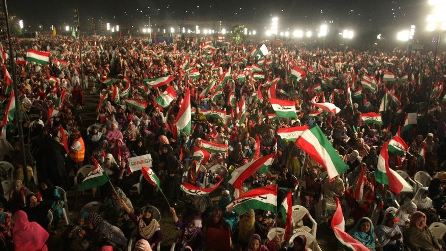 Thousands of supporters of Pakistan's fiery cleric Tahir-ul-Qadri take part in an anti government rally in Lahore, Pakistan, Sunday, Oct. 19, 2014. Thousands of anti-government protestors  led Muslim cleric Tahir-ul-Qadri rallied in Lahore demanding Prime Minister Nawaz Sharif's ouster over alleged fraud in last year's election. (AP Photo/K.M. Chaudary) (AP Photo/K.M. Chaudary)