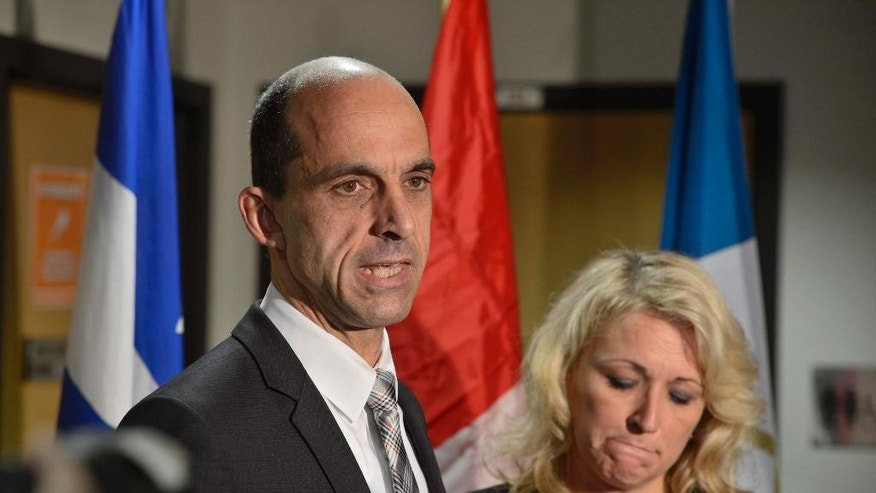 Public Safety Minister Steven Blaney and Transport Minister Lisa Raitt address reporters at a news conference in St-Jean-sur-Richelieu, Quebec, on Tuesday Oct. 21, 2014. One of two soldiers hit by a car on Monday in Saint-Jean-sur-Richelieu, Quebec, died of his injuries early Tuesday, according to Quebec provincial police. An official familiar with the case said the suspect, Martin Couture Rouleau, 25, of Saint-Jean-sur-Richelieu, was influenced by radical Islamists. (AP Photo/The Canadian Press, Paul Chiasson)