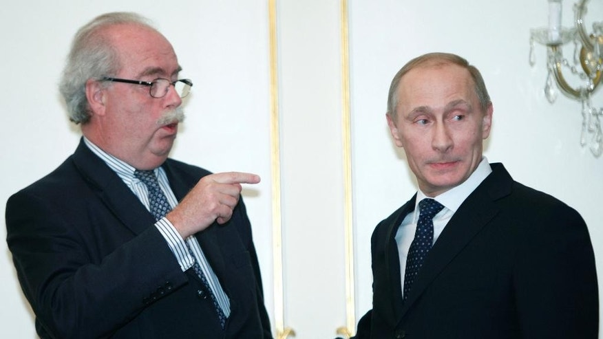"""FILE - In this March  2, 2011 file photo, Russian Prime Minister Vladimir Putin, right, listens to French energy giant Total CEO Christophe de Margerie after a signing ceremony at the Novo-Ogaryovo residence outside Moscow,  Russia. The CEO of French oil giant Total SA was killed when his corporate jet collided with a snow removal machine Monday night, Oct. 20, 2014, at Moscow's Vnukovo Airport, the company said. Total """"confirms with deep regret and sadness"""" that Chairman and CEO Christophe de Margerie died in a private plane crash at the Moscow airport, the company said in a press release dated Tuesday, Oct. 21,  and posted on its website. (AP Photo/Alexander Zemlianichenko, File)"""