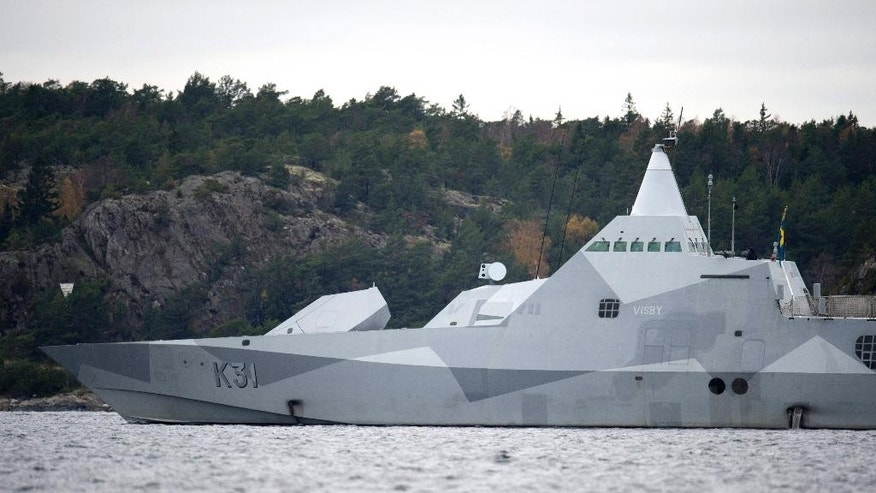 Oct. 21, 2014: The Swedish corvette HMS Visby navigates on Mysingen Bay, as the search for a suspected foreign vessel enters it's fifth day in the Stockholm archipelago.  (AP/TT News Agency)