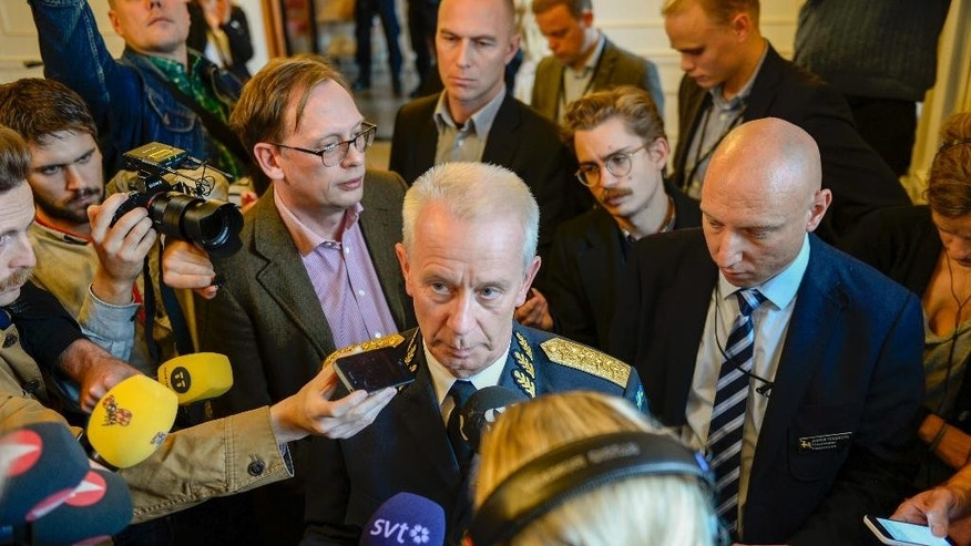 Oct. 21, 2014: Swedish Commander-in-Chief Sverker Goransson talks to media after a nearly two-hour long meeting with the Swedish Parliament defence committee behind closed doors in Stockholm. (AP/TT News Agency)