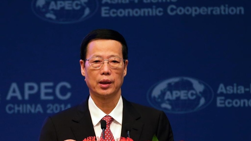Chinese Vice Premier Zhang Gaoli delivers his opening remarks at the Asia-Pacific Economic Cooperation (APEC) finance ministers meeting at the Diaoyutai State Guesthouse in Beijing Wednesday, Oct. 22, 2014. Asia Pacific finance ministers are meeting Wednesday to consider coordinated responses amid concerns over a slowdown in the regional economy highlighted by lower Chinese growth figures. (AP Photo/Andy Wong)