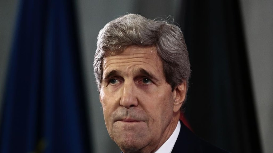 United States Secretary of State John Kerry addresses the media during a news conference with German Foreign Minister Frank-Walter Steinmeier in Berlin, Wednesday, Oct. 22, 2014. (AP Photo/Markus Schreiber)