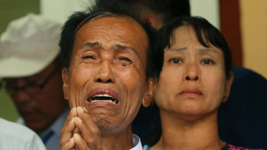Tun tun Htike, left, and May Thein,  parents of Myanmar migrant worker Win Zaw Htun cry while addressing the media at the Myanmar Embassy in Bangkok ,Thailand Wednesday, Oct. 22, 2014. Myanmar migrant workers Win Zaw Htun and Zaw Lin, have retracted their confessions to killing two British travelers on a southern Thai resort island and now claim to have neither raped the female victim nor slain the pair, the men's lawyers said Wednesday.  (AP Photo/Sakchai Lalit)