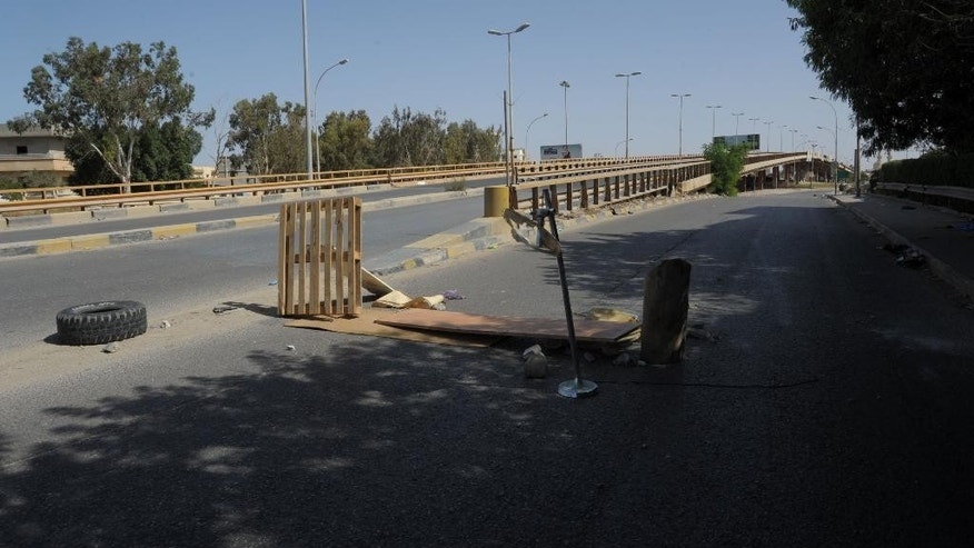 The streets remain empty as fighting raged  between Islamist militias and forces loyal to Libya's elected government in Benghazi, Libya on Friday, Oct. 17, 2014.  The latest cycle of violence follows more than two years of dashed hopes and failed attempts by civilians to stand up to the Islamist militias. Activists, judges, journalists, policemen and army officers have been gunned down in a series of assassinations carried out by assailants who have not been caught. As the central government flounders, hard-line Islamists act with impunity.  (AP Photo/Mohammed Elsheiky)