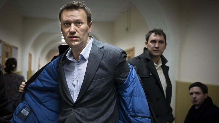 FILE - In this Wednesday, March 13, 2013 file photo, Russian opposition activist Alexei Navalny prepares to speak to journalists outside a courtroom in Moscow, after his appeal against the country's top investigative agency was rejected. Navalny, along with his brother Oleg, is facing a trial for allegedly defrauding a French cosmetics company in a criminal case in which no injured party has stepped forward. The opposition alleges that the Kremlin has cooked up a slew of dubious cases against Navalny allies: One was charged with stealing a painting even though the painter said it was never stolen; another was charged with defrauding Navalny of campaign funds despite a lack of anybody to complain of such theft. (AP Photo/Alexander Zemlianichenko, File)
