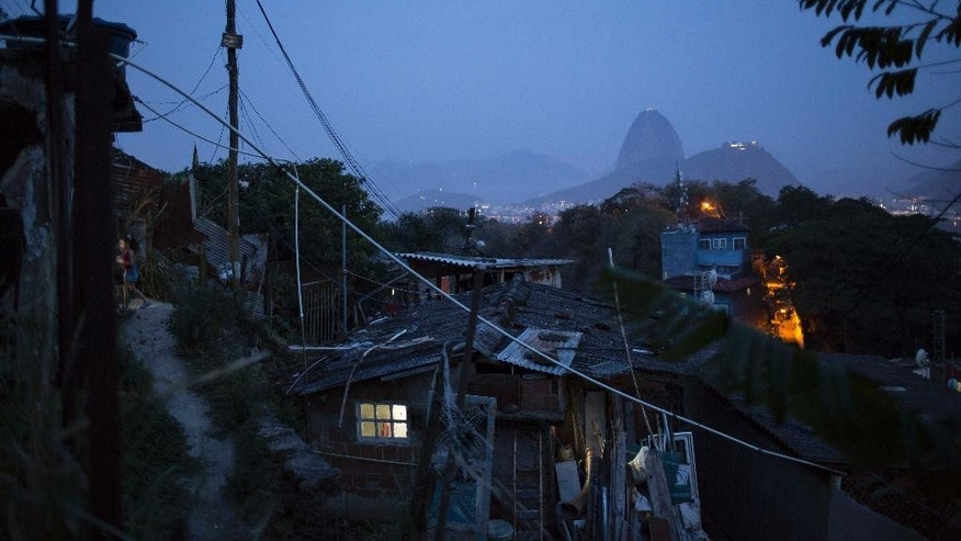 In this Oct. 16, 2014 photo, the Sugar Loaf Mountain, top right, and homes are seen from the top of the Dona Marta slum in Rio de Janeiro, Brazil, ahead of a presidential election run-off on Sunday, Oct. 26. Crucial to President Dilma Rousseff's re-election is whether lower middle class voters are convinced that only she and the Workers' Party can secure gains. They are the class of voter most sensitive to economic shifts _ they're just well off enough to not take part in government cash-transfer programs, but not rich enough to have cushions against economic shocks. (AP Photo/Felipe Dana)