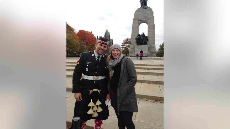 In this photo provided by Megan Underwood, Steph Winsor, right, poses for a photo with Cpl. Nathan Cirillo, on Sunday, Oct. 19, 2014, in front of the National War Memorial, in Ottawa, Ontario. Cirillo was killed by a gunman on Wednesday, Oct. 22, while he was on post at the National War Memorial. (AP Photo/Megan Underwood)