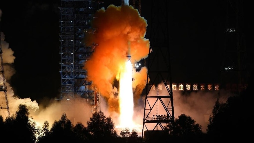 In this photo released by China's Xinhua News Agency, an unmanned spacecraft is launched atop an advanced Long March 3C rocket from the Xichang Satellite Launch Center in southwest China's Sichuan Province, Friday, Oct. 24, 2014. China launched an experimental spacecraft Friday to fly around the moon and back to Earth in preparation for the country's first unmanned return trip to the lunar surface. (AP Photo/Xinhua, Jiang Hongjing) NO SALES