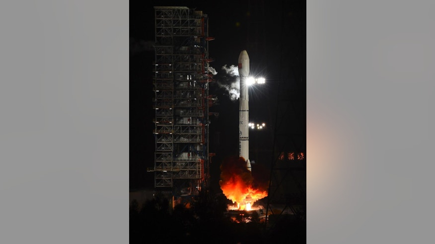 In this photo provided by China's Xinhua News Agency, an unmanned spacecraft is launched atop an advanced Long March 3C rocket from the Xichang satellite launch center in southwest China's Sichuan Province, Friday, Oct. 24, 2014.  China launched an experimental spacecraft Friday to fly around the moon and back to Earth in preparation for the country's first unmanned return trip to the lunar surface. (AP Photo/Xinhua, Jiang Hongjing) NO SALES