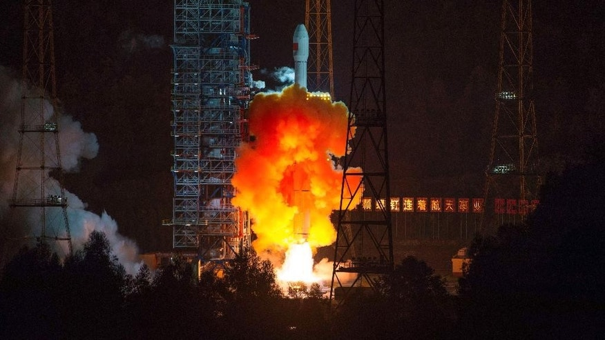 An unmanned spacecraft is launched atop an advanced Long March 3C rocket from the Xichang Satellite Launch Center in southwest China's Sichuan Province, Friday, Oct. 24, 2014. China launched an experimental spacecraft Friday to fly around the moon and back to Earth in preparation for the country's first unmanned return trip to the lunar surface. (AP Photo) CHINA OUT