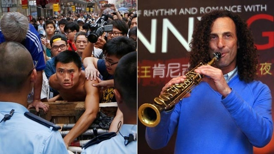 At left, A protester bleeds from his face as he tries to stop a group of taxi drivers from trying to remove the barricades in the Mong Kok district of Hong Kong Wednesday. At right,  Kenny G, smooth jazz saxophonist, performs during a media event announcing a concert, in Taipei, Taiwan in 2010. (AP Photo/Kin Cheung, File)