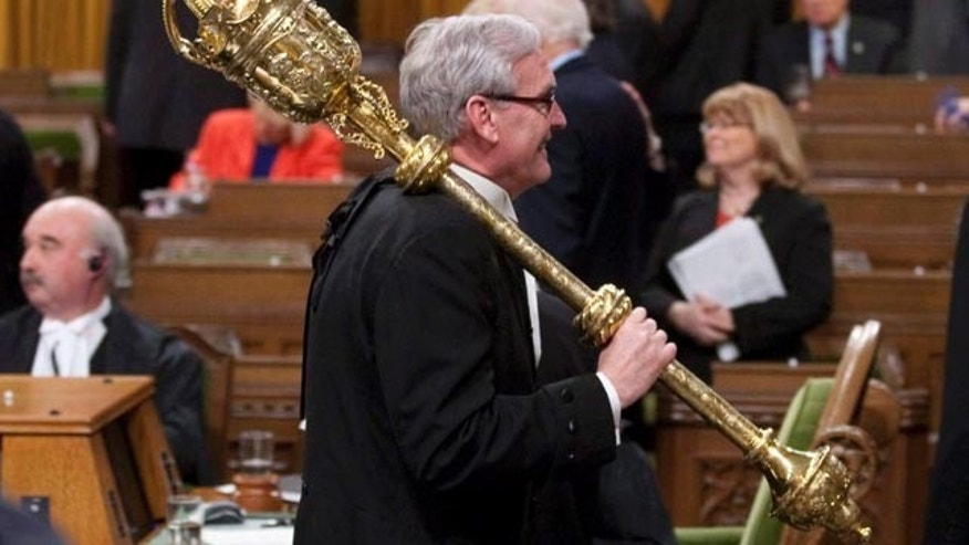 FILE In this March 25, 2011 file photo, Sergeant-at-Arms Kevin Vickers carries the mace from the House of Commons at the conclusion of the session in Ottawa. (AP Photo/The Canadian Press,Adrian Wyld)