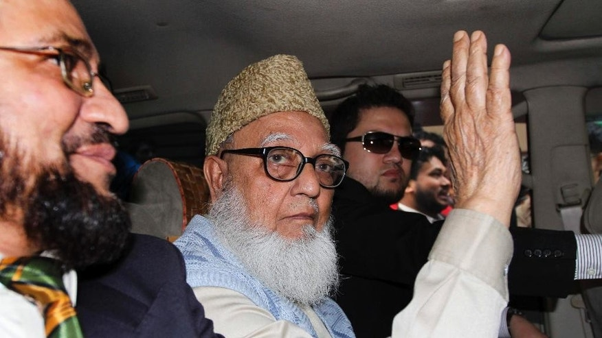 FILE - In this Wednesday, Jan. 11, 2012 file photo, former chief of Bangladesh's largest Islamic party Jamaat-e-Islami, Ghulam Azam, waves from inside a car on his way to a court in Dhaka, Bangladesh. Azam, 91, died late Thursday, Oct. 23, 2014 after life support was removed at the Bangabandhu Sehikh Mujib Medical University in the capital, Dhaka, said hospital spokesman Abdul Majid Bhuiyan. (AP Photo/Shawkat Khan)
