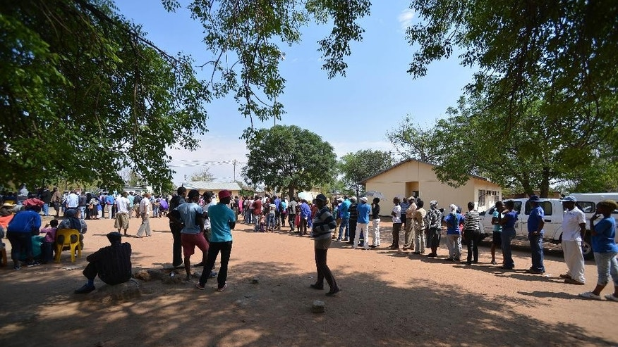Voters queue to cast their votes at a polling station in Gaberone, Botswana, Friday, Oct. 24, 2014. Electoral officials say that voting has begun without incident where analysts believe the ruling party will win despite growing discontent in urban areas. (AP Photo)