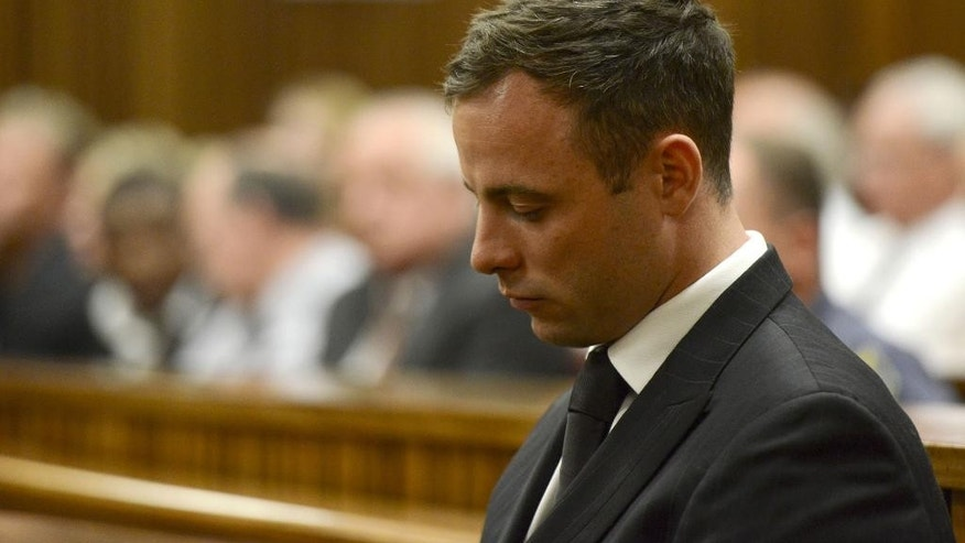 Oscar Pistorius sits in court in Pretoria, South Africa, Tuesday, Oct. 21, 2014 after judge Thokozile Masipais sentence Pistorius to five years imprisonment for culpable homicide in the killing of his girlfriend  Reeva Steenkamp last year.  (AP Photo/Herman Verwey, Pool)
