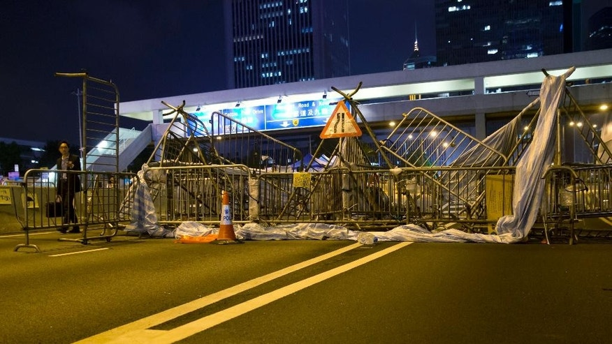 A mask is seen on the road near a barricade at the occupied area in Central of Hong Kong Thursday, Oct. 23, 2014. As thousands of protesters block city streets demanding democratic reforms, the future of Hong Kong's exclusive — some would say purposefully opaque — election committee may prove key to defusing a high-stakes political standoff that has dragged on for nearly a month. (AP Photo/Kin Cheung)
