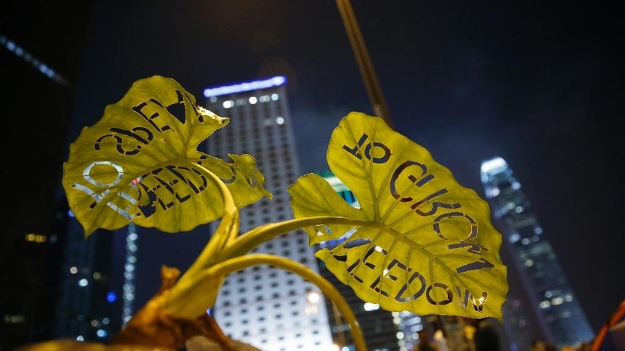 "A plant with words cutout ""To grow freedom, to speak freedom"" is displayed at the occupied area in Central of Hong Kong Thursday, Oct. 23, 2014. As thousands of protesters block city streets demanding democratic reforms, the future of Hong Kong's exclusive — some would say purposefully opaque — election committee may prove key to defusing a high-stakes political standoff that has dragged on for nearly a month. (AP Photo/Kin Cheung)"