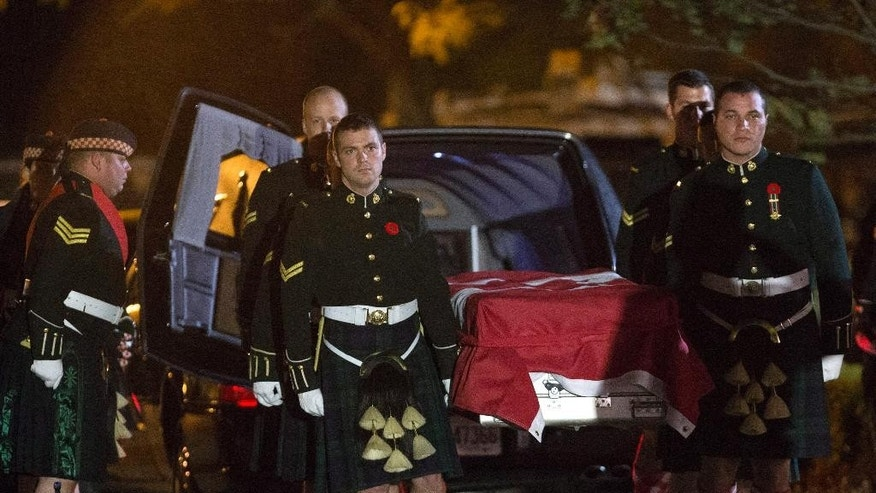 The body of Cpl Nathan Cirillo is carried by his fellow soldiers into the Markey-Dermody Funeral Home in Hamilton, Ontario on Friday, Oct. 24, 2014. The 24-year-old reservist was gunned down as he stood ceremonial guard at the National War Memorial in Ottawa on Wednesday. (AP Photo/The Canadian Press, Peter Power)